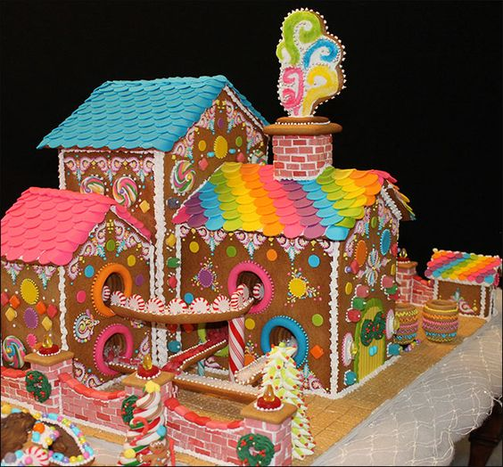 Gingerbread house candy factory with barrrels of candy on a conveyor belt by Lynne Schuyler